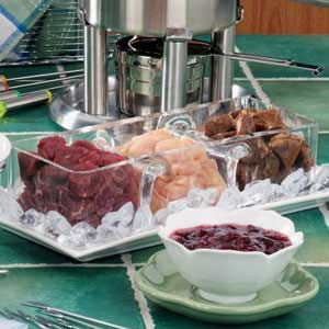 Marinated Tenderloin Fondue Recipe -When I was a kid in the 1970's, Mom made fondue a lot. She served this meaty version every New Year's Day. Now I carry on that fun tradition with my own family.