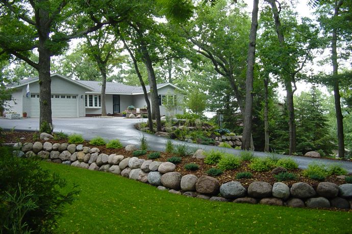 26 best images about home backyard retaining wall on for Natural landscape design