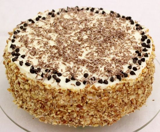 Cannoli Cake | Cannoli cake is a take on the beloved Italian cannoli pastry. The best part is the luscious, velvety filling. Smooth and creamy, this filling is the perfect texture and combination to complement the tender sponge cake.