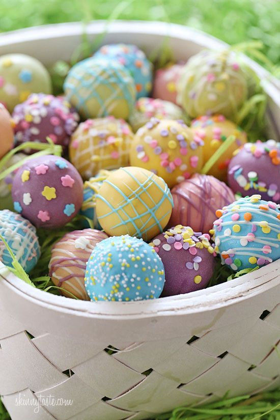 A fun Easter dessert idea, cake balls decorated as Easter eggs! Put them in a basket and watch them disappear.  We are all ready for the Easter bunny in my home. We painted some eggs, we made cake balls, maybe we'll even get to see the Easter bunny himself.  These cake balls were fun to make, and are made lighter than traditional cake balls by using a box cake mix, egg whites and fat free Greek yogurt – no oil, no butter required! Because I use a cake ball pan, there's no need to mix the…