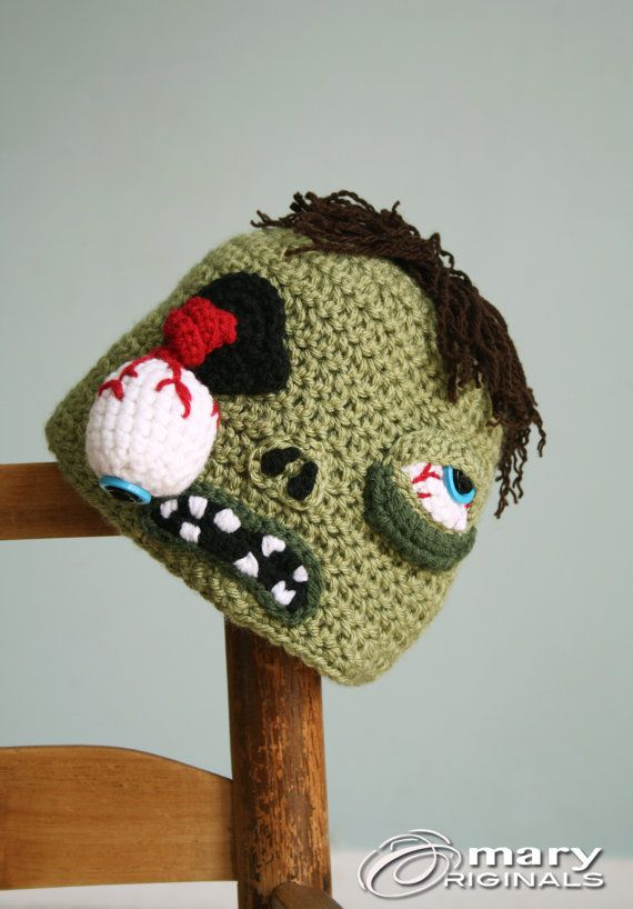 Braaaiiiiinnnsssss...braaiiinnssss!!!! Who doesnt love a gross, creepy, adorable zombie! This awesome zombie hat is hand made using crochet and