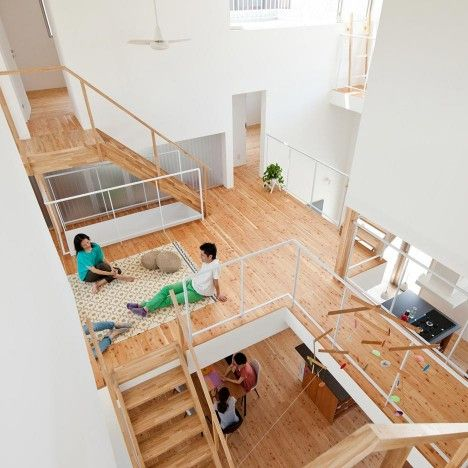Share House LT Josai in Nagoya, Japan, contains 13 bedrooms. These 7.2-square-metre spaces are arranged around voids that contain shared open-plan living, dining and kitchen areas.