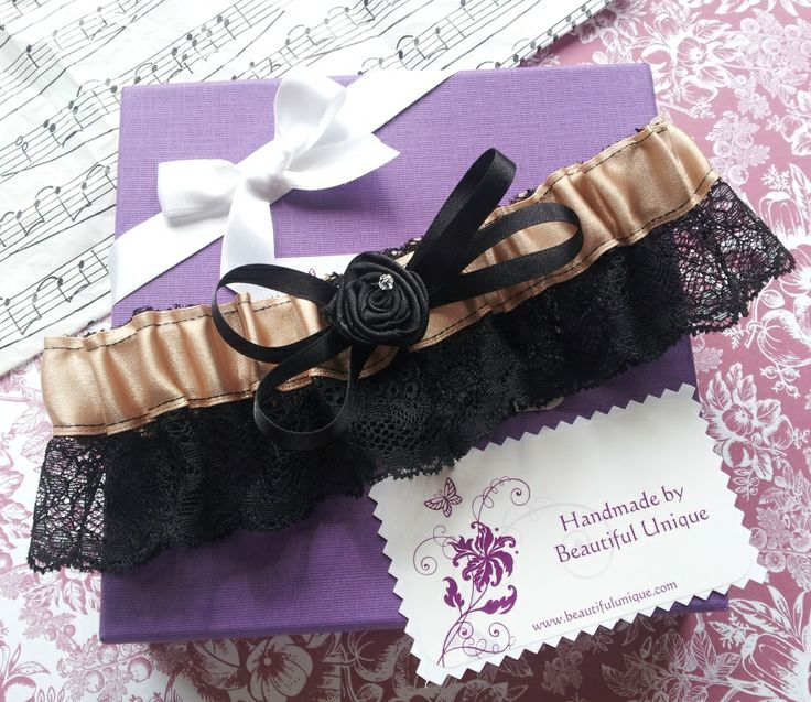 Handmade gold and black garter with ribbon motif