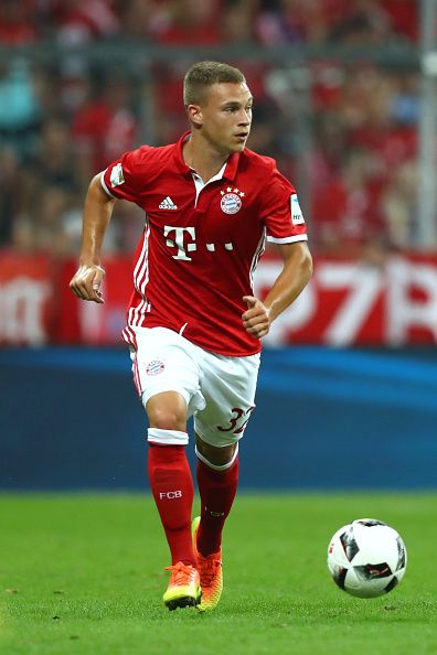 Joshua Kimmich of Muenchen runs with the ball during the Bundesliga match between Bayern Muenchen and Werder Bremen at Allianz Arena on August 26...