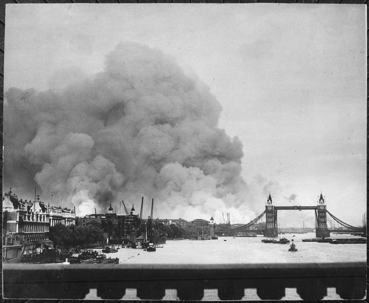 This picture, taken during the first mass air raid on London, 7th September 1940, describes more than words ever could, the scene in London's dock area. Tower Bridge stands out against a background of smoke and fires. New York Times Paris Bureau Collection.