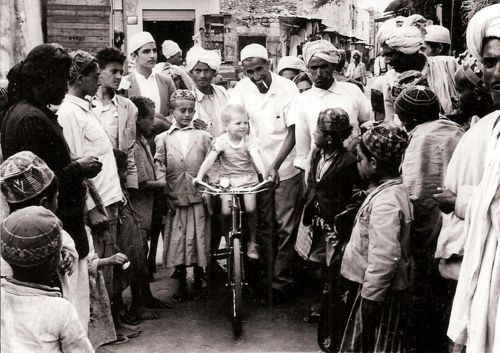 """Early 1960s  """"This picture is from the early 1960s, and shows my dad (the little white baby) surrounded by a crowd of friendly Yemeni people."""""""