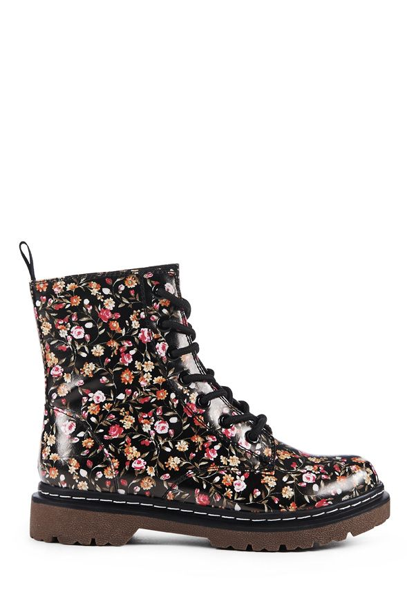The 90's are so in bloom and we love her throwback style. Florah by JustFab is an allover floral print lace-up combat bootie with contrast stitching at the sole.