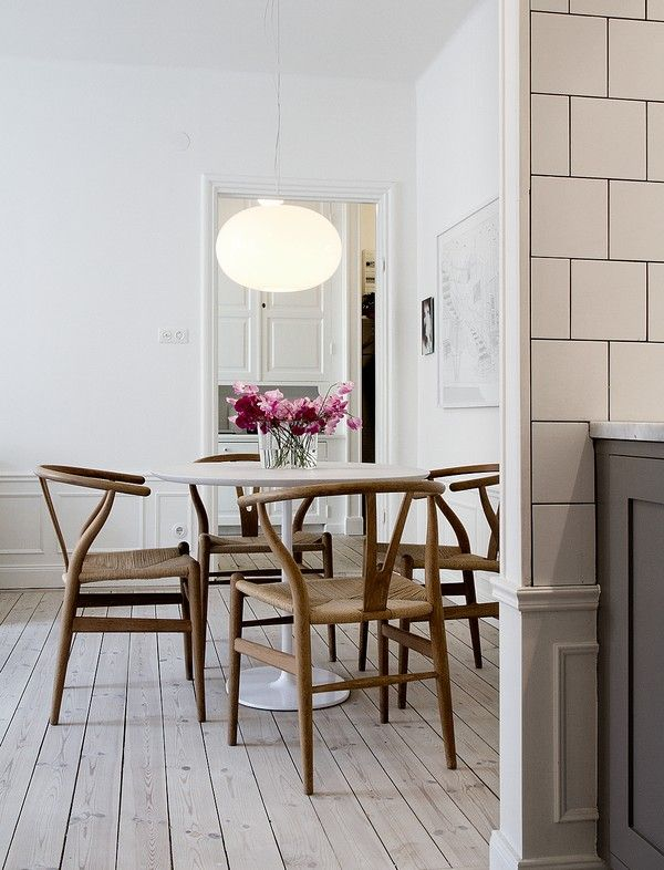 Dining Area With Round Table And Wishbone Chairs By Hans J Wegner