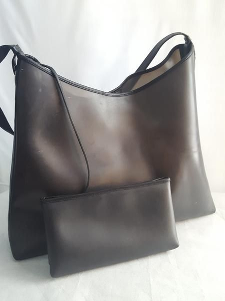Charcoal PVC and leather Hobo bag with mini inside bag. In good preloved condition, has some stains otherwise excellent condition. PLEASE SEE PICS