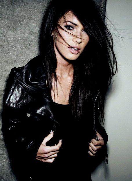 megan fox... soooo pretty. black hair, black shirt, black jacket, black makeup.