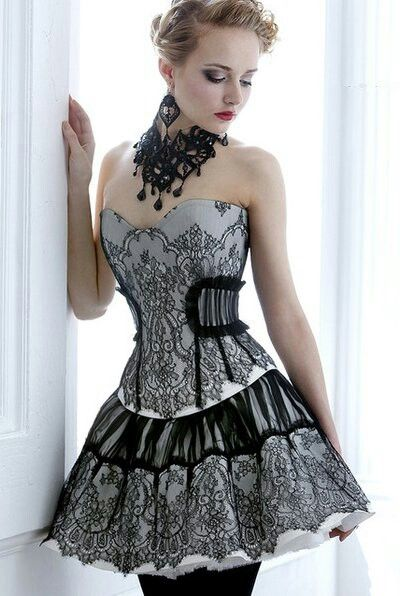 The essence of sweetness and class in a short corset dress.