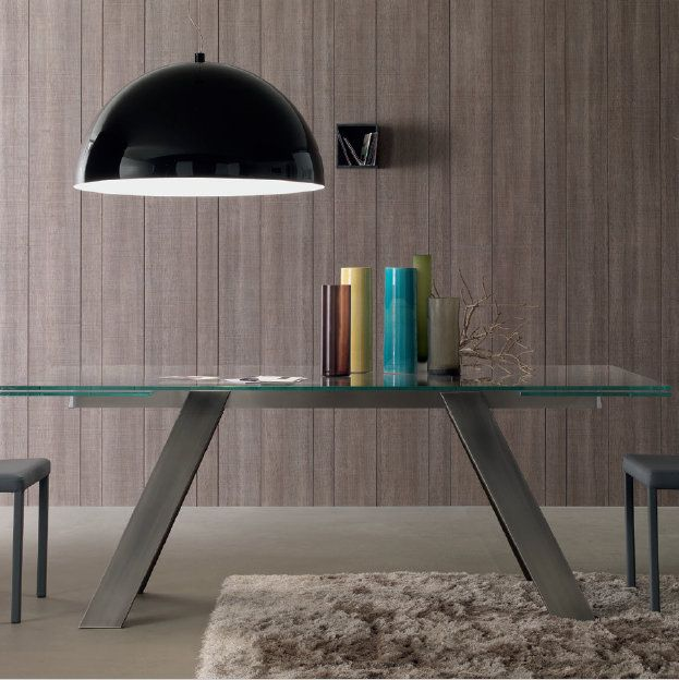 Traverse Table This glass and wood table is very elegant and may be the great centrepiece both to your living room and dining room. The materials are all high-quality, reliable and durable.