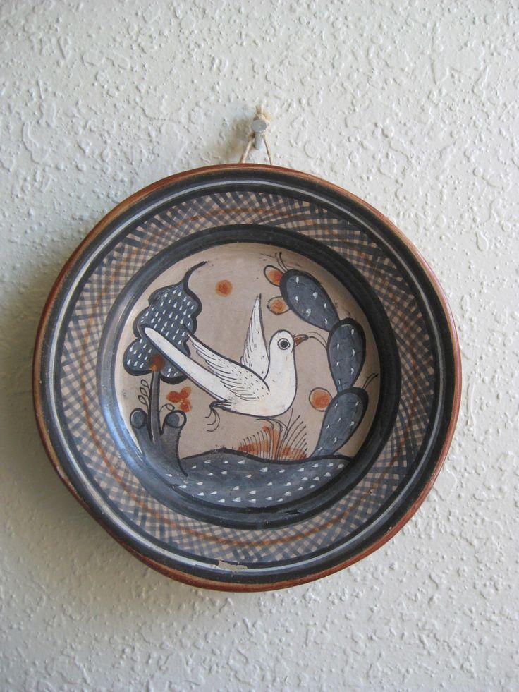 Rustic Wall Decor- Primitive Plate- Tonala Jalisco Pottery- Mexican Folk Art Ceramic Wall Decor- Rustic Wall Decor- Bird Plates by squaregrannyvintage on Etsy https://www.etsy.com/listing/246207640/rustic-wall-decor-primitive-plate-tonala