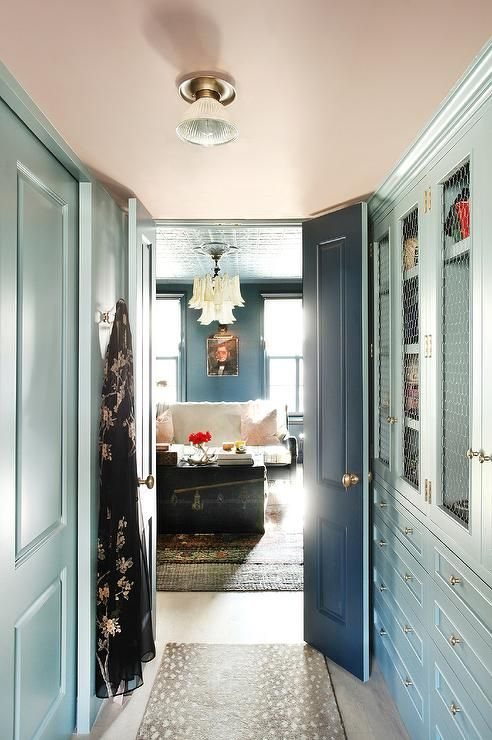 His and her blue walk in closet customized with a pink ceiling does not lack storage and style.