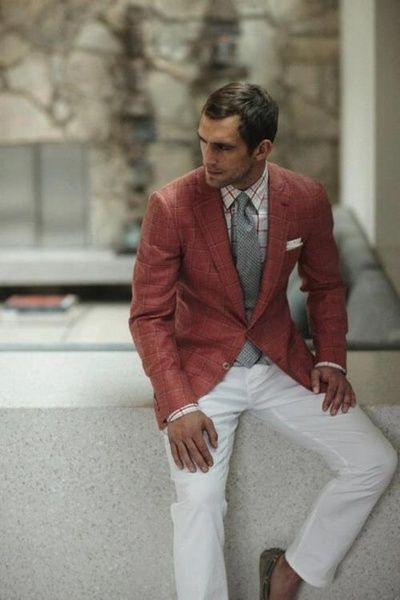Love the loud blazer matched with the neutral whites.