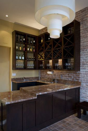exposed brick with dark contemporary cabinets and light countertop, wine bar
