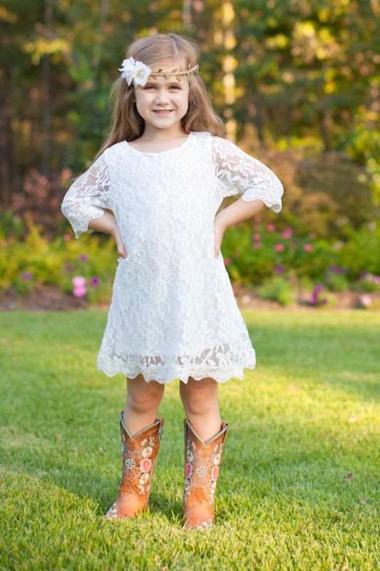 "A perfect outfit showcasing Southern charm! This white lace bell sleeve dress is one of our favorites! Be sure to get this dress for your little girl in time for your holiday photos or for a perfect Christmas present! Perfect to pair with cowboy boots and lace boot socks.  <span style=""color: #f5a2a4;"">Item is in stock and will ship in 7-10 business days. </span> <a style=""text-decoration: underline; color: #f5a2a4;"" title=""How It Works 