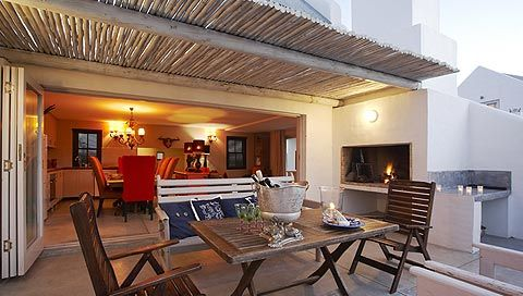 Outdoor dining area at these sea side cottages.