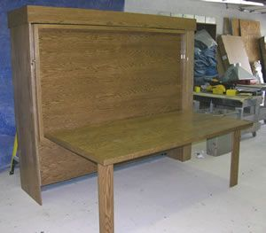 Murphy Bed that can be used as a table when it is folded up.