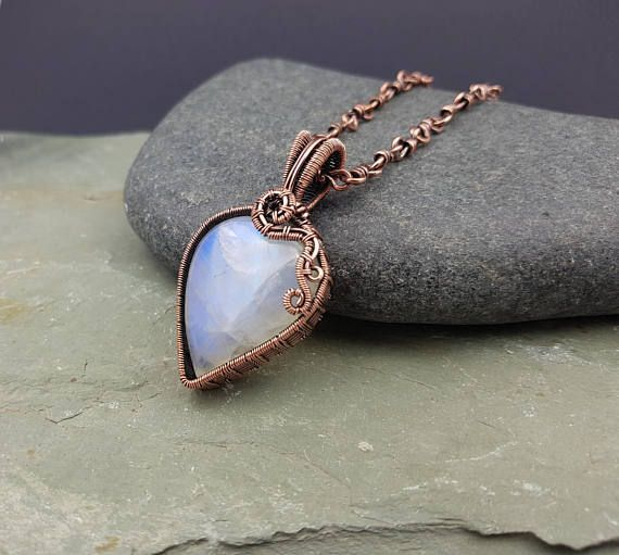 This stunning rainbow moonstone pendant has been wire wrapped and hand woven in solid copper wire around a beautiful rainbow moonstone cabochon to make this statement necklace which would make the perfect copper anniversary gift for her. I have given the piece a patina to age the copper #anniversarygifts