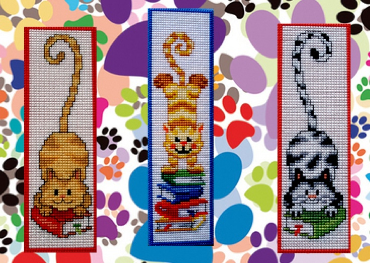 Made by Marian. Bookmarks reading cats embroidered on plastic canvas. A 'Vervaco' cross stitch Bookmark kit.