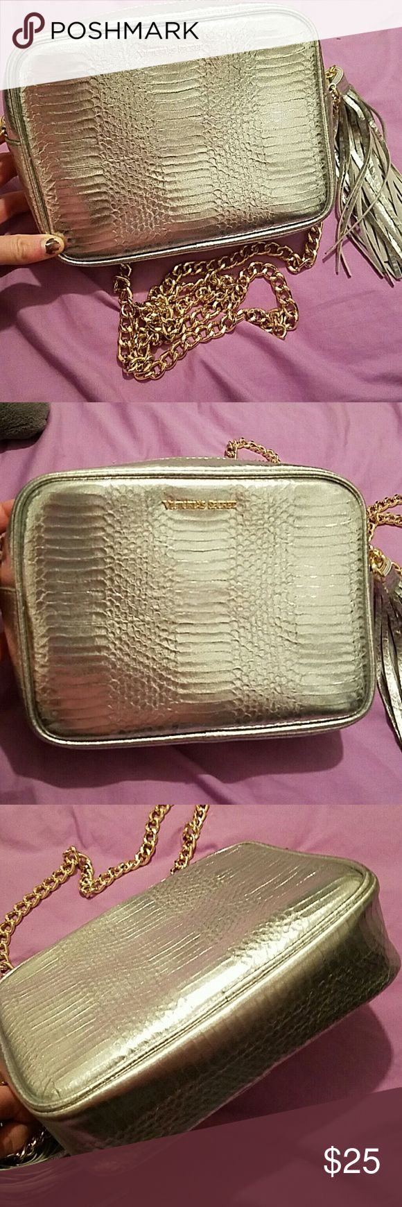 Victora Secret Purse 2016 VS fashion show exclusive purse. Brand new never used, only open to take pictures. Silver with tassel a day gold chain strap Victoria's Secret Bags