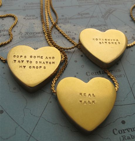 """We'll customize this 1"""" brass heart necklace with the message of your choice.  KONICHIWA, BITCHES.  $65-$85"""
