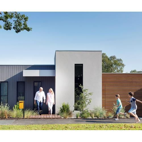 Building on a sloping block was a welcomed challenge for this Melbourne couple who went for a spilt level house design with living areas on the entry level and bedrooms below to draw light into the south-facing rear. Take a tour. Photography: Martina Gemmola   Story: Australian House & Garden
