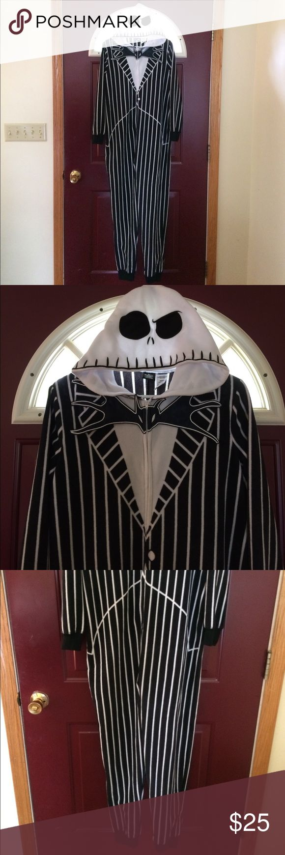 Jack Skellington One Piece Set From director Tim Burtons film The Nightmare Before Christmas comes this one piece fleece Jack Skellington outfit. Size medium, would be fine for ladies, would probably fit men's small size. Front zip closure with hoodie. Would be great to wear while out trick or treating with the kids, or greeting the kids at the door wearing it. In EUC with no rips stains or holes. Comes from a smoke free home. Please ask if you have any questions! Disney Other