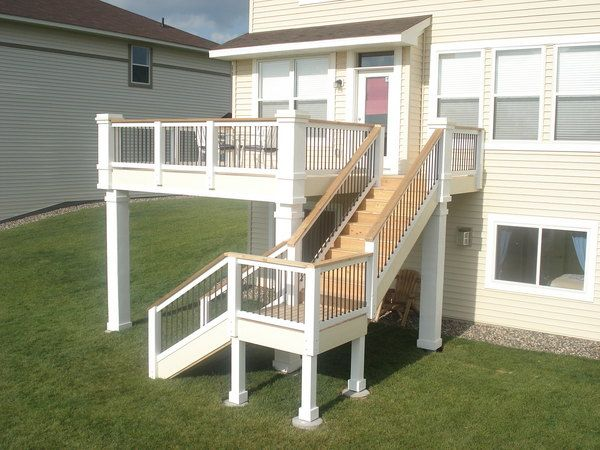 Second floor deck stairs how to build a deck step by for Second floor deck
