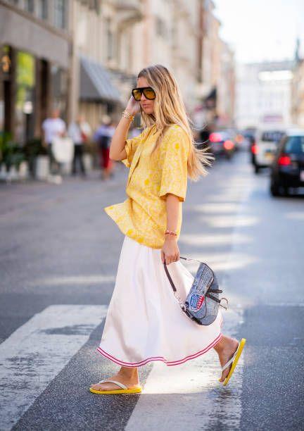 e4389902732f Emily Sindlev wearing Dior saddle bag yellow button shirt striped skirt flip  flops seen outside Mykke Hofmann during the Copenhagen Fashion Week.