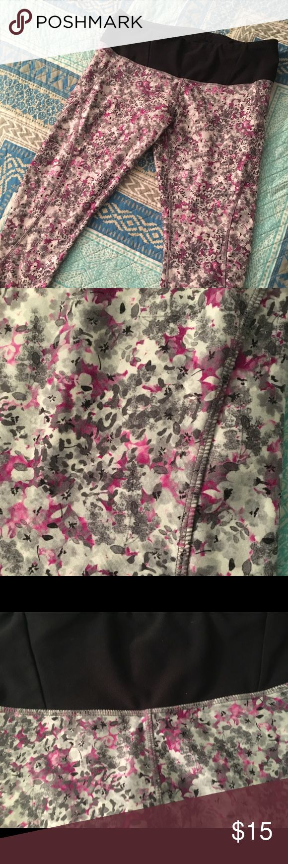 Floral print capri gym leggings Floral print gym capri leggings with black block accents on the sides of the calves ...  Floral pattern is purple/grey/black with black waistband and zipper-close pocket on back of waistband to hold a key or something small  88% polyester / 12% spandex   Gently used and in good condition MPG Pants Leggings