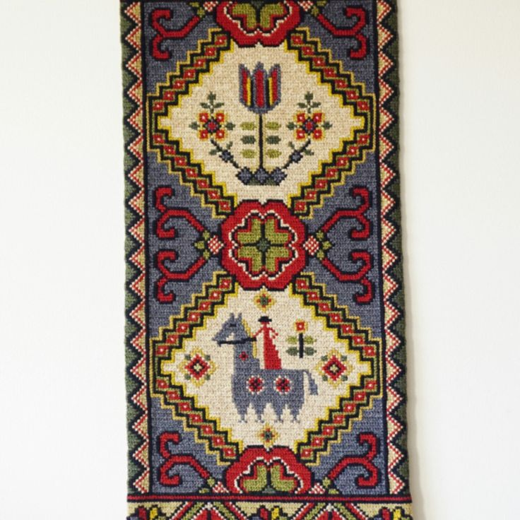 Swedish traditional twist stitch wool wall hanging.