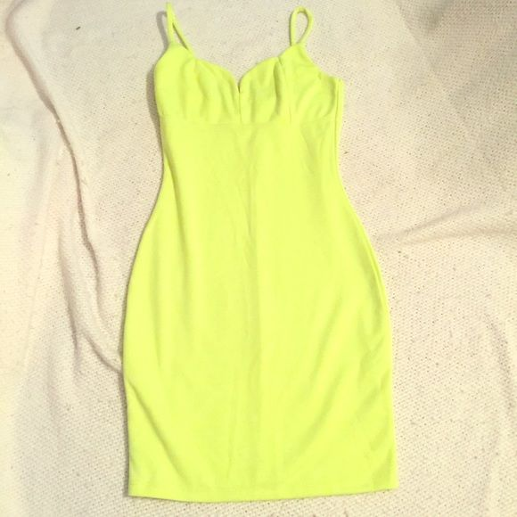 Fun lime green night out dress. This lime Green Party starter is brand new, never worn before piece. It's tight fitted and is thigh high, the perfect dress to wear for a night out. Charlotte Russe Dresses