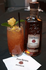 Cherry Blossom Julep  1 ½ oz Four Roses Single Barrel Bourbon  1 ½ oz Dried Cherry Lemon Zest Gastrique   Fresh mint   2 oz Tamarind Soda   2 oz Ginger Ale   Using a large mixing glass, muddle gastrique and mint. Add bourbon and shake well. Pour into tall highball glass and top with equal parts tamarind soda and ginger ale. Garnish with candied ginger rose, mint sprig and lemon zest.  http://204.17.36.44/Briefs/Forms-Files/Derby_March_2011.html