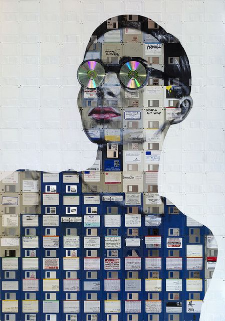 """KALEIDOSCOPE by Nick Gentry  2013 Oil and used computer disks on wood"" The outdated technology is laid out and, making a woman."