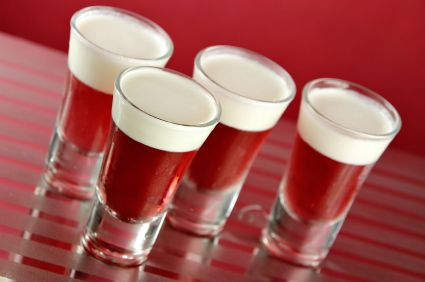 Apple Vodka Jello Shot: 3 ounce box apple Jell-O, 1 cup boiling water, 1 cup vodka, Sweet Whipped cream