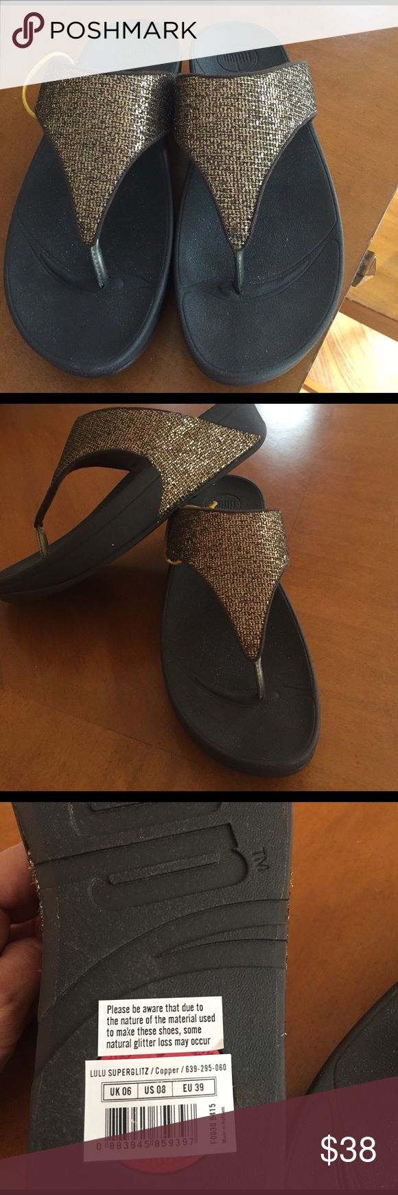 Fitflop sandals Fitflop bronze colored sparkly flip flops. Very comfortable. Brand new. fitflop Shoes Sandals