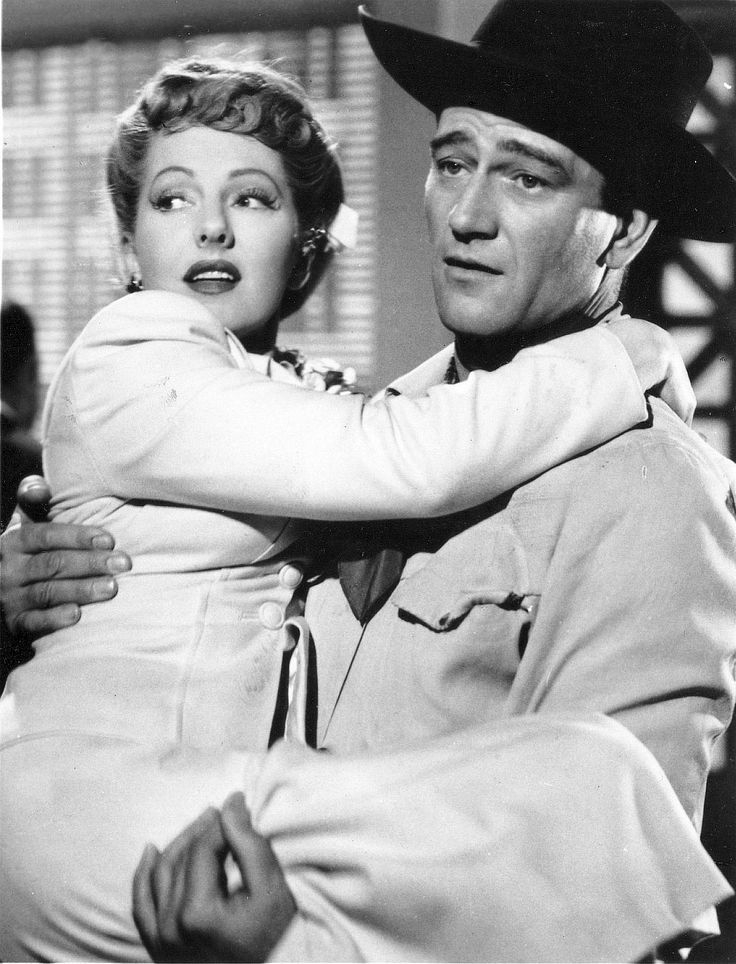 """Jean Arthur, John Wayne.  """"A Lady Takes a Chance"""". It's not a very good movie but they're cute. :)"""