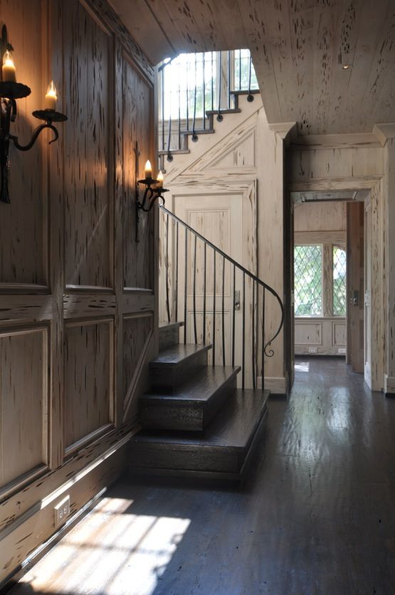 Distressed pecky cypress wormwood paneling. Sans the outdated sconces, I could live with interior walls like this for a lifetime.