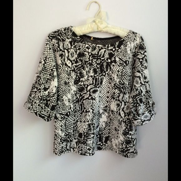PRICE DROP Black and White Top Black and white short sleeve top in graphic design. Very soft and comfortable. Tops