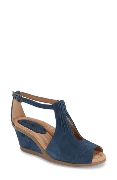 What I like about this shoe: it's different from other t straps I've seen and I like the detail on the front. I've been hunting for a great pair of navy wedges.