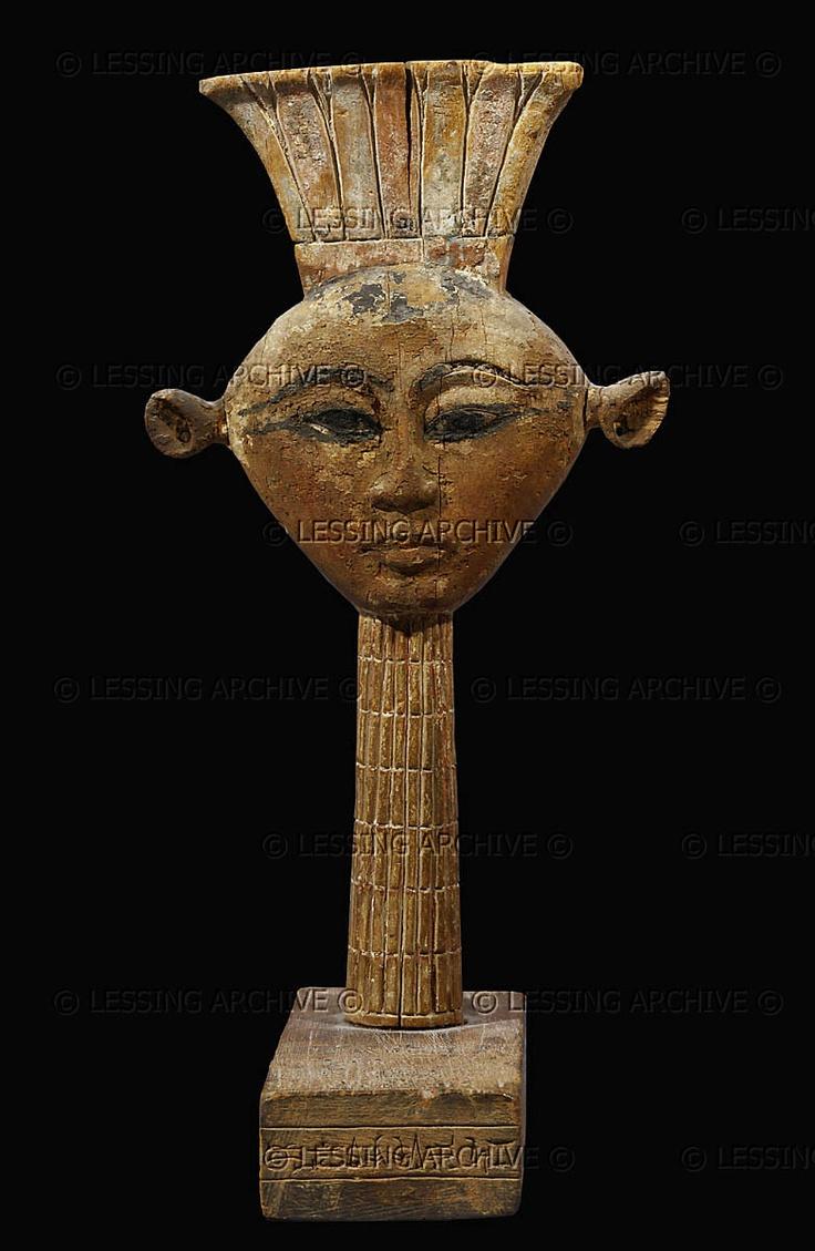 EGYPT WOODCARVING 12TH BCE Head of the Goddess Anukis,local goddess of Elephantine Island,Egypt. Her cows ears are reminiscent of the Goddess Hathor. 19th Dynasty, 1295-1186 BCE Painted wood, H: 27,5 cm Inv.N 3534 Louvre, Departement des Antiquites Egyptiennes, Paris, France