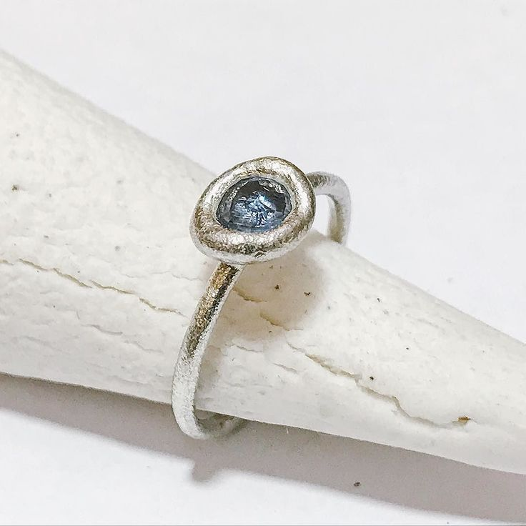 #onthebench  Understated luxury. Finished this baby yesterday and sending it out to its new owner very soon. . Blue sapphire and white gold bud ring . #rosecutsapphire #tamaragomezjewellery #rawluxury #spiritinspired #bluesapphires #naturalstyle #finejewelry #cockpitarts #rusticluxury #madeinlondon #finejeweller #luxuryjewellery #onlinejewellery #showmeyourrings #jewelleryaddict #jewelrylovers #girlboss