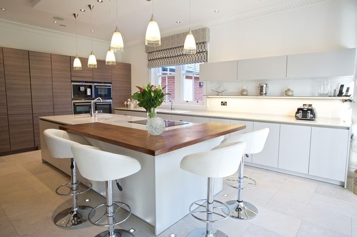 Contemporary Kitchen Chandlers Ford. Mix up your surfaces. The cooking and eating zones on this island unit have been ingeniously divided up, thanks to different worktop materials.