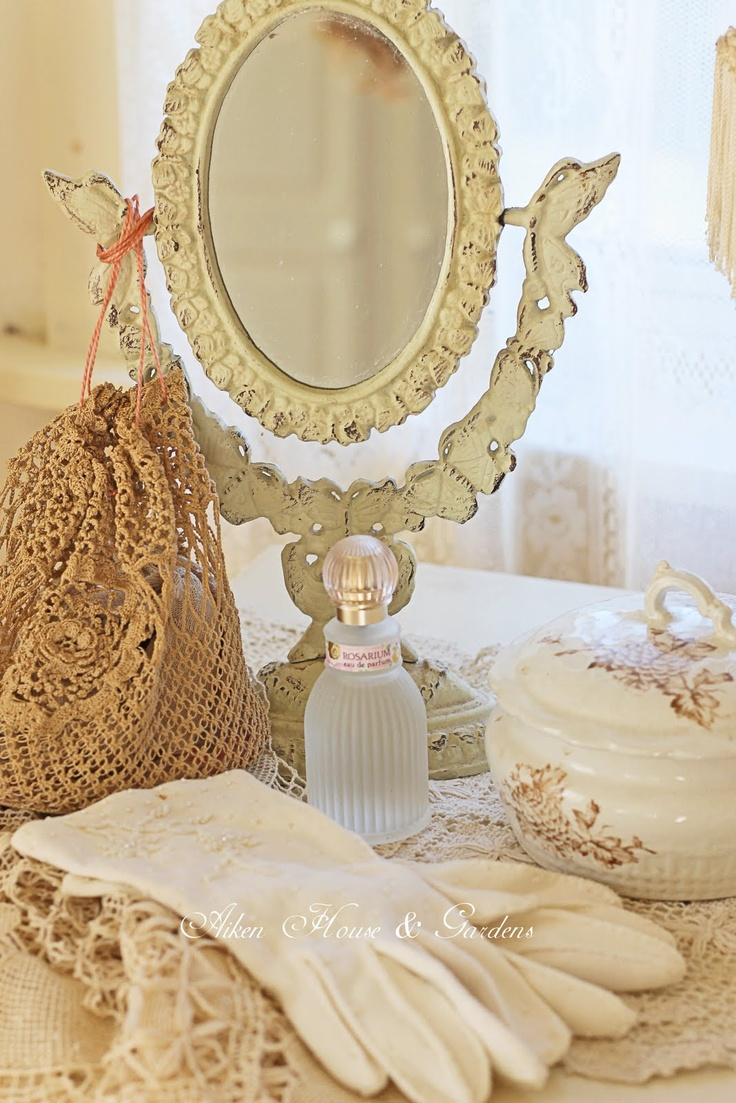 Romantic vanity top strewn with standing adjustable mirror, and  gloves, lace, bits & pieces (1) From: Warren Grove Garden,