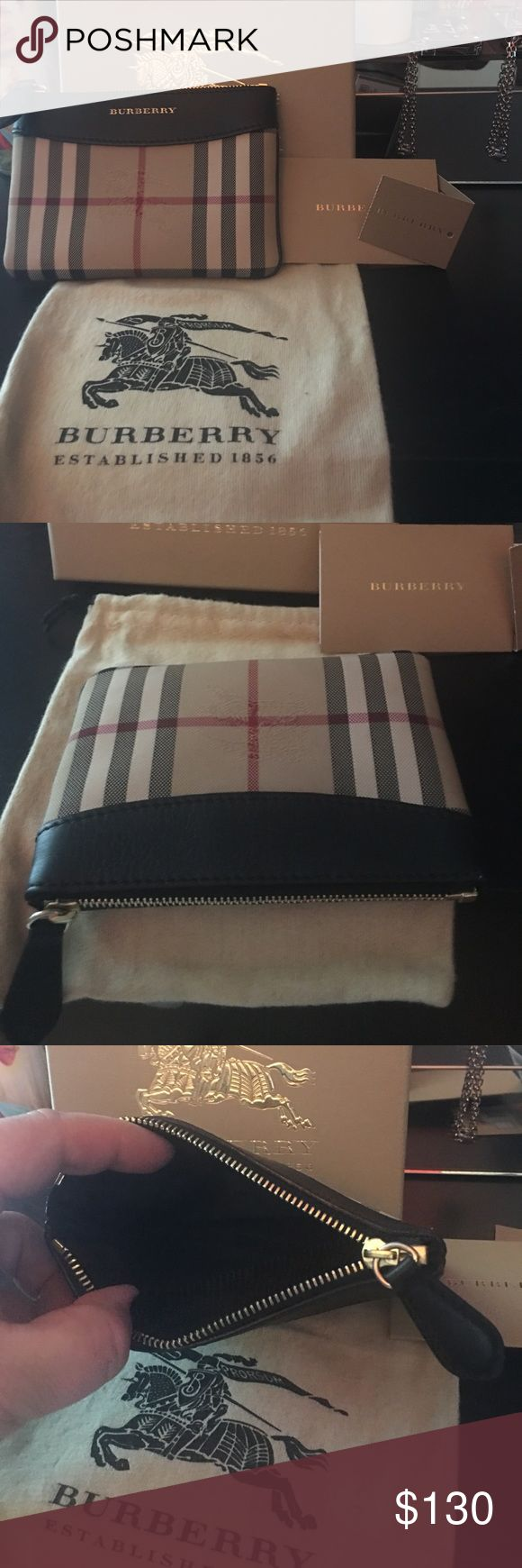 Authentic Burberry coin purse Authentic Burberry coin purse comes with everything shown in picture.  Still in amazing shape Burberry Bags Wallets