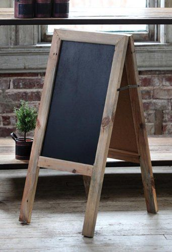 Two sided reclaimed wood chalkboard. This could be a lot of fun to build and use in the backyard.