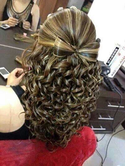 Gorgeous spiral curls with cute hair bow - Get this look by curling hair in the grooves of the Rock N Roller iron.