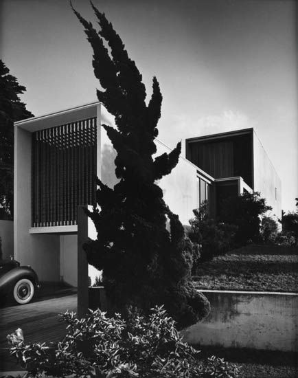 Julius Shulman utilizing the classic modernist shot. Hollywood Juniper in foreground.